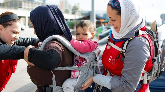 Carry The Future Hand-Delivers Hope and Necessities to Refugees Giving Compass