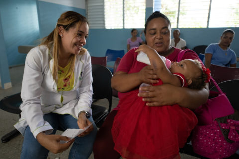 A mother and baby receive care at the Tamboril Municipal Hospital in the Dominican Republic. The hospital is a long-time recipient of Americares aid, most recently benefitting from renovations in the laboratory and on-site pharmacy, as well as mental health and psychosocial support training for staff. Photo by Jeff Kennel/Americares.